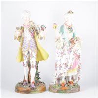 Lot 21-A pair of German porcelain figures, lady and...
