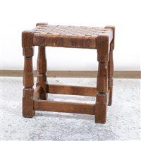 Lot 509-Robert 'Mouseman' Thompson of Kilburn, an oak stool with woven leather seat.
