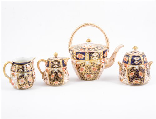 Lot 69-Davenport Imari pattern three-piece tea set, Imari milk jug and sugar bowl, and cauldron sugar, etc.