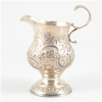 Lot 76-George III silver helmet-shape cream jug, maker's mark M?, London, 1764.