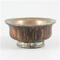 Lot 65-Tibetan turned wood bowl, with white metal lining and foot-rim.