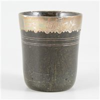 Lot 67-Turned hardstone beaker, with a white metal rim, probably 18th century.