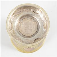Lot 49-German silver parcel gilt beaker, set with 18th century coins.