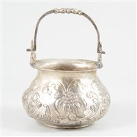 Lot 54-White metal cauldron-shape bowl with swing handle.