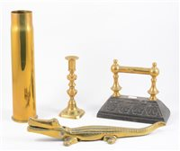 Lot 106-Quantity of brass fireside items.