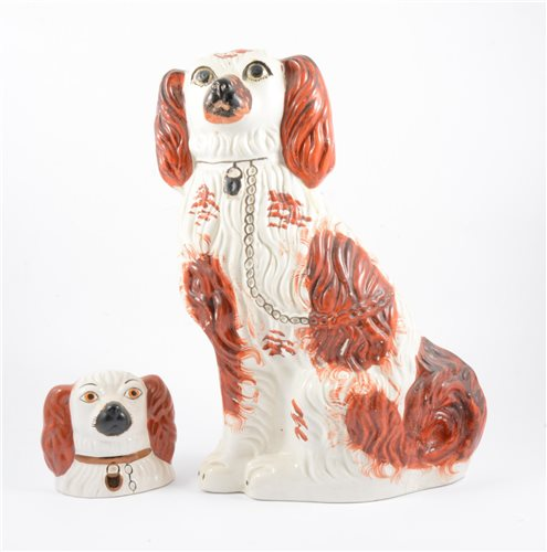 Lot 31-A pair of Staffordshire pottery models, seated King Charles Spaniels