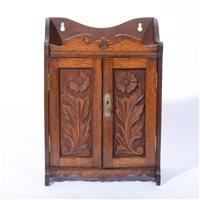 Lot 84-Edwardian oak smokers cabinet