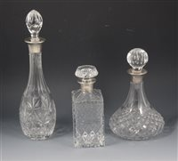 Lot 35-Three silver-mounted contemporary glass decanters