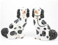 Lot 5-Two 19th Century Staffordshire King Charles spaniels