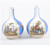 Lot 25-A pair of Dresden bottle vases, blue and white ground panels alternating with decoration of a courting couple and flowers, marked AR, 24cm.
