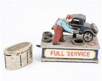 "Lot 125-""Full Service"" cast iron novelty money box and a Lloyds Bank money box. (2)"