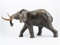 Lot 117-Cast metal model of an elephant, 26cm high, 46cm long.