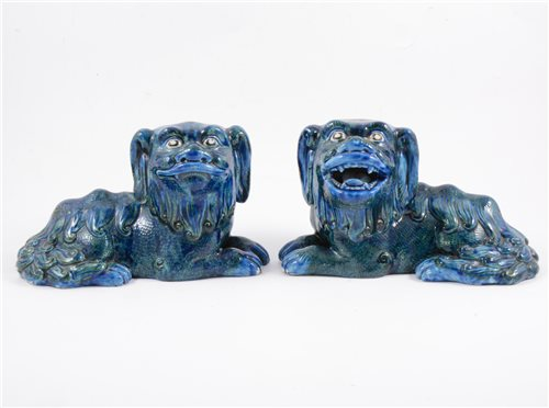 Lot 78-A pair of Guangdong blue and green glazed lions, late Qing