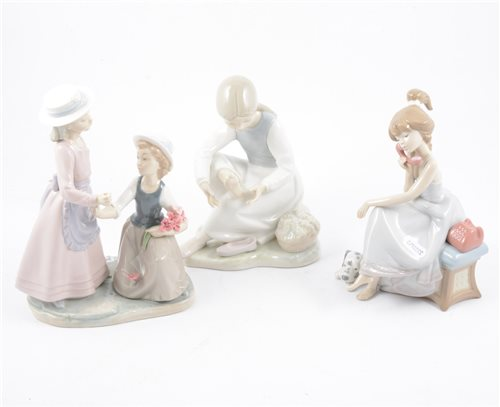 Lot 81-A Lladro figure of a young girl on a telephone and seven other Nao figures of children (8)