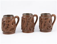 Lot 100-A set of six Shanghai carved wooden tankards, metal lined.