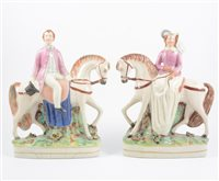 Lot 22-A pair of Victorian Staffordshire pottery figures, the Prince and Princess of Wales