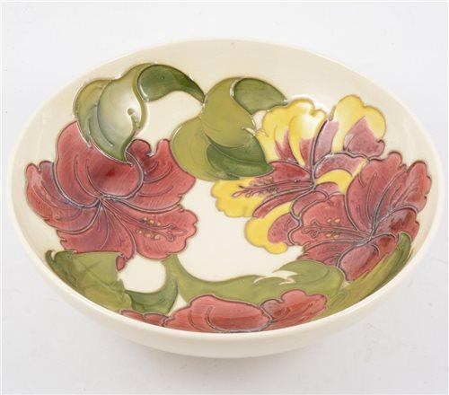 """Lot 70-A Moorcroft bowl in the """"Hibiscus"""" design on cream ground, 26cm diameter."""