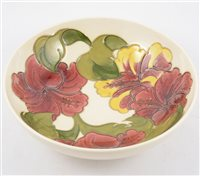 "Lot 70-A Moorcroft bowl in the ""Hibiscus"" design on cream ground, 26cm diameter."