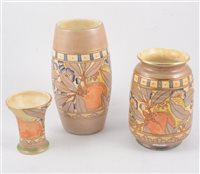 "Lot 59-Three Burleigh Ware vases - in the ""Pomegranate"" design two signed by Charlotte Rhead 23cm and 17cm, an unsigned 10cm vase. (3)"