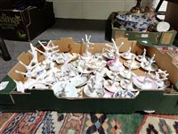 Lot 96-A large quantity of ring trees (approx. 40), including Limoges and Arcadian crested china.