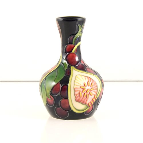 Lot 15-A Moorcroft Pottery vase, 'Queens Choice' designed by Emma Bossons.