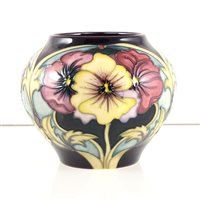 Lot 549-A Moorcroft Pottery vase, 'Pansy' designed by Rachel Bishop.