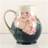 Lot 544-A Moorcroft Pottery jug, 'Rose' designed by Sally Tuffin.