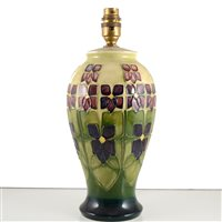 Lot 540-A Moorcroft Pottery lamp base, 'Violet' designed by Sally Tuffin.