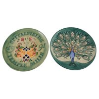 Lot 546-Two Moorcroft Pottery year plates, 'Peacock' 1994; and 'Spitalfields Temple Mills' 1991