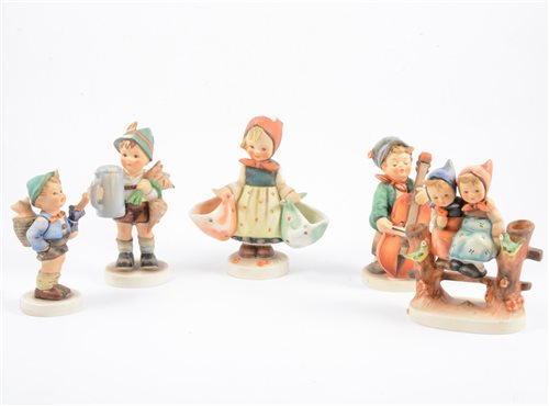 Lot 24-A collection of sixteen Goebel Hummell figures, to include Apple Tree Boy and Girl, Meditation, For Father and Home From Market, (16).