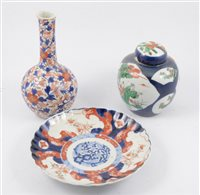 Lot 74-Chinese polychrome ginger jar; an Imari bottle vase; two Imari plates; and an Isnik style plate.
