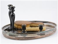 Lot 95-Silver plated galleried tray with two pairs of ebony candlesticks and a brush set