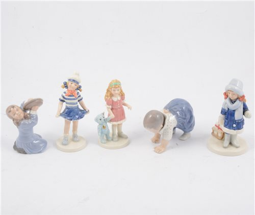 Lot 71-A collection of Danish figurines - B&G cream glazed baby figures 2204/7/8/9