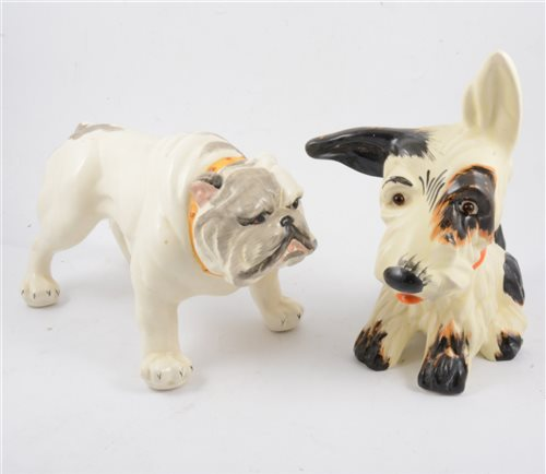"Lot 36-Six Crown Devon dog figures, a glass eyed gloss ""Sealyham Terrier"" doorstop filled with sand, 18cm, three ""Scottie Dogs"" a 17cm sand filled doorstop with glass eyes"
