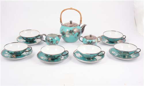 Lot 28-A six-piece Bavarian porcelain tea set with silver overlay