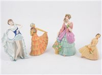 "Lot 66-Twelve Crown Devon lady figurines, five in the art deco style and having ""Sutherland Figures"" paper labels, two Crown Figurines, ""From Paris"" and ""Caroline"". (12)"