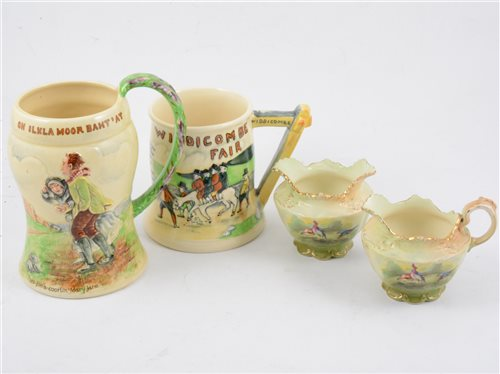 Lot 80-A set of three Crown Devon pheasant jugs, a similar milk jug with pewter cover and a small milk and sugar
