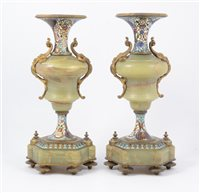 Lot 91-A pair of green marble and cloisonne enamel garnitures, vase shaped candleholders each standing on six enamel feet, 32cm high.
