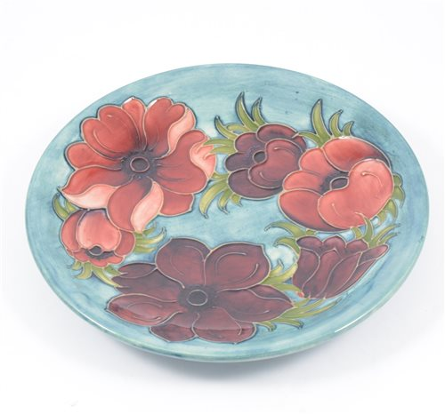 """Lot 7-A Moorcroft """"Anemone"""" shallow dish on smokey blue/green ground, 25.5cm, signed and impressed Moorcroft Made in England."""