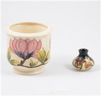 Lot 11-Moorcroft jardiniere and small baluster vase. (2)