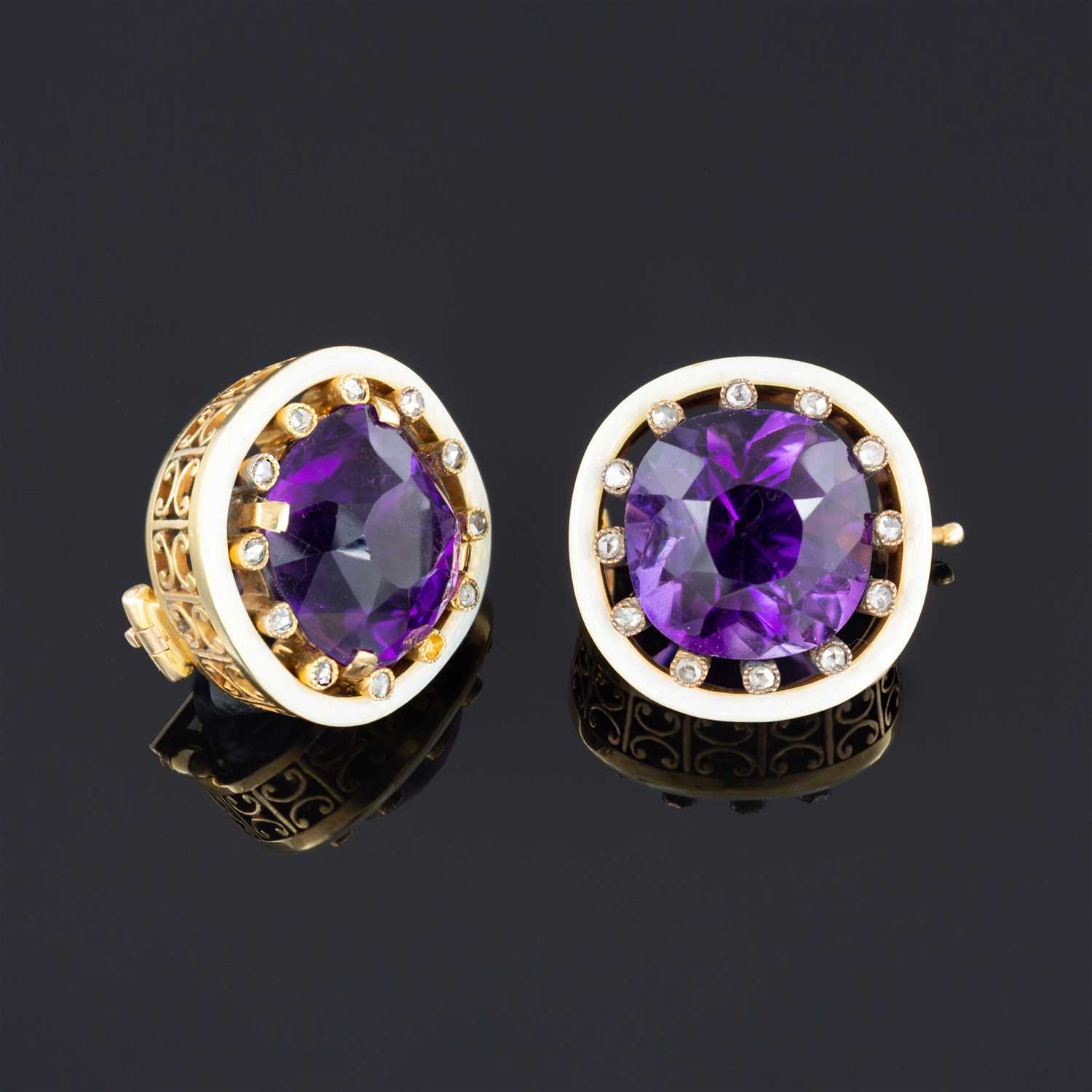Lot 264-A pair of Fabergé amethyst and diamond lapel brooches