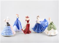 Lot 21-A collection of mainly Royal Doulton figurines, comprising the Pretty Ladies collection 'Laura', 'Soiree', 'Elaine' HN4718 and 'Elaine' in pink, Pretty Ladies Best of the Classics 'Susan'.. (8)