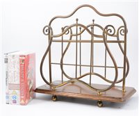 Lot 97-An Edwardian style magazine rack, oak platform, width 39cm, and a collection of DVD's.