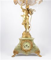 Lot 85-French onyx and gilt spelter figural mantel clock table lamp, and a similar figural table lamp [2]