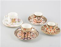 Lot 49-A collection of Royal Crown Derby china teaware, cups and saucers, various Imari and posy patterns.