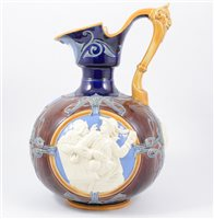 Lot 36-Large majolica Tavern jug, attributed to Minton, moulded relief figural panels