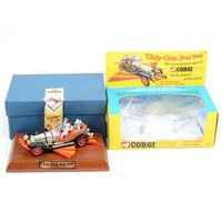 Lot 128-Corgi Toys Chitty Chitty Bang Bang with automatic flip-out wings diecast model, a reproduction of the 1960s model, boxed with wooden plinth.