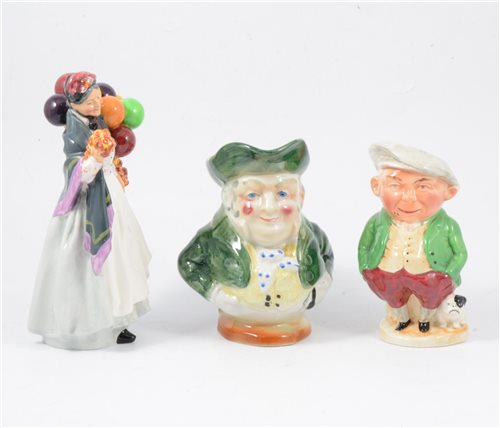 Lot 34-Royal Doulton figure, Biddy Pennyfarthing, HN1843; four toby jugs, a figural flask and a bowl
