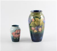 Lot 11-A Moorcroft 'Clematis' vase, 18cm, signed in green WM, impressed Moorcroft Made in England and a Moorcroft 'Poppy' vase, 9.5cm, impressed Moorcroft Made in England (2).