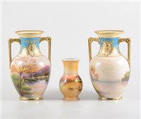 Lot 7-A pair of Noritake twin-handled vases, painted with a bridge and small village scene, gilt border, 18cm, and a Noritake vase, painted with a pastoral scene, 11cm. (3)